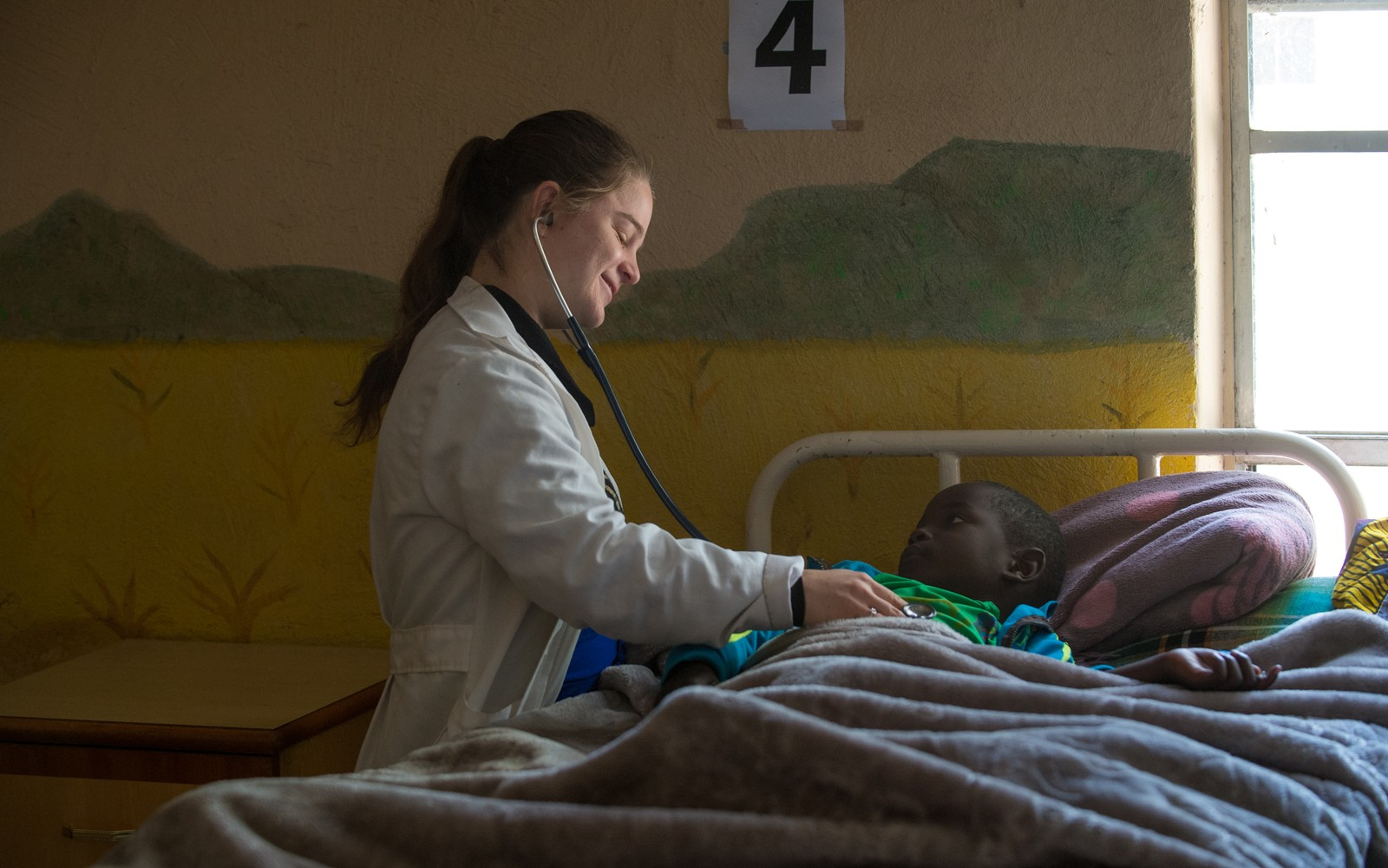 Volunteer Doctor Mary Fleming helping a child at Mutomo Mission Hospital in Kenya in March 2018