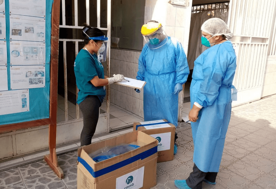 Health workers unpack PPE provided by CMMB's medical donation program