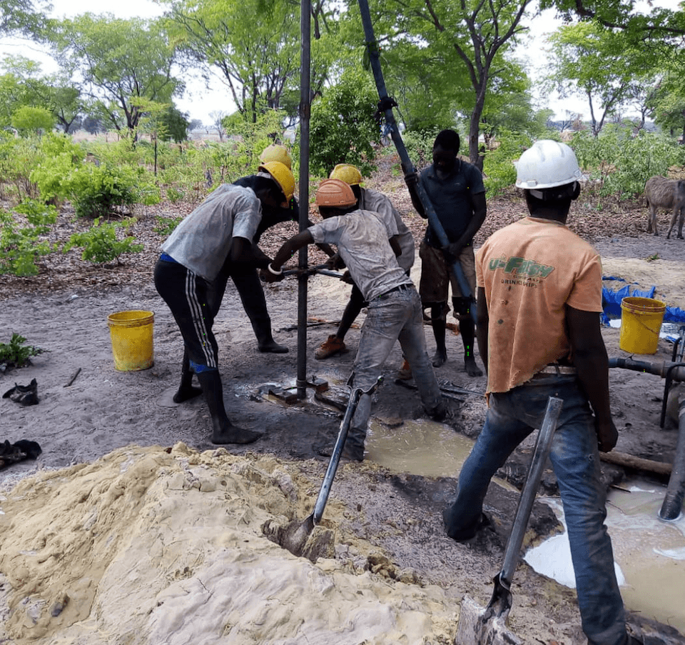 Workers dig a well with tools donated by cmmb donors in Mwandi, Zambia