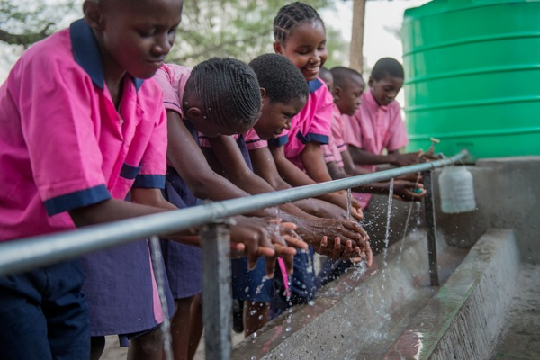 Students washing their hands with clean water at a primary school in Mwandi, Zambia in October 2019.