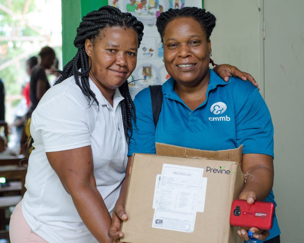 Communite health workers holding a box of medical supplies in Cotes de Fer in Haiti in September 2019.