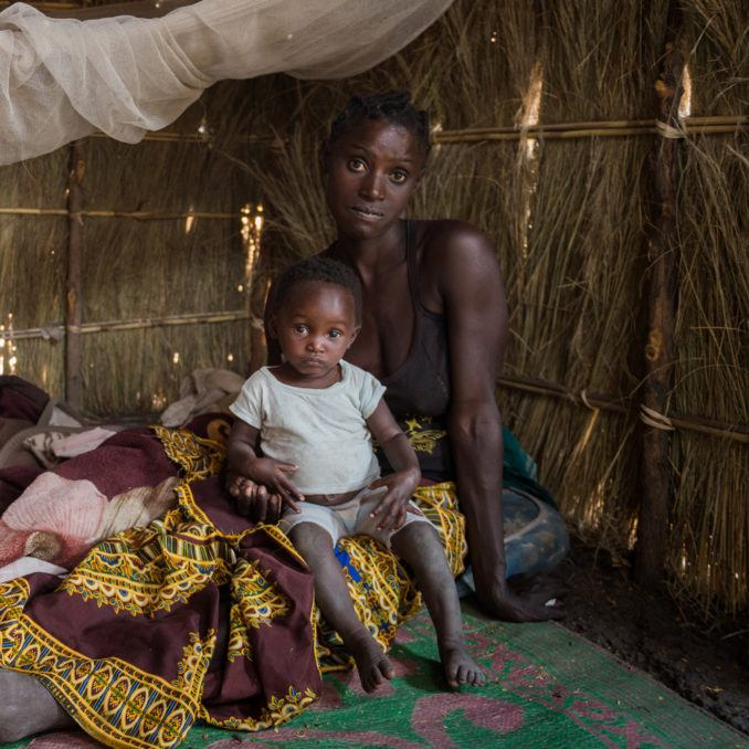 A mother with her child in her thatched home in Zambia in October 2019.