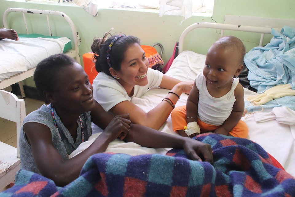 Samantha Hodge with a young patient in Kenya in 2019