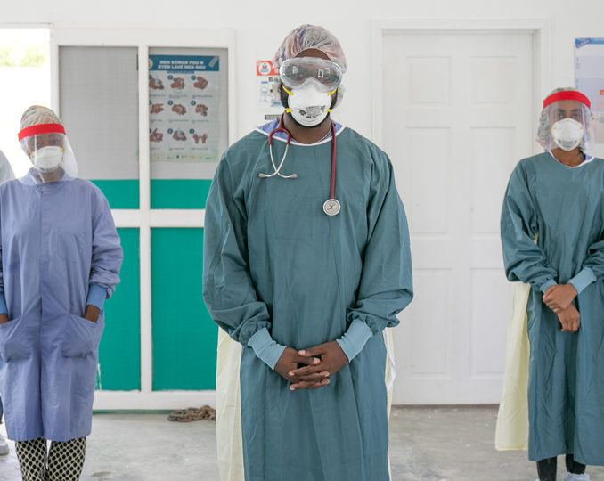 Community health workers dressed in PPE as part of CMMB's COVID-19 response in Haiti in July 2020.
