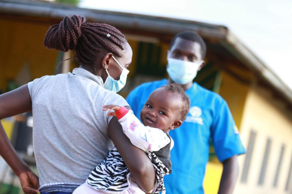 mom and child with community health worker