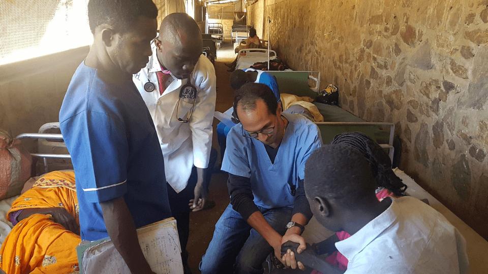 Dr. Jose treats a patient in Sudan