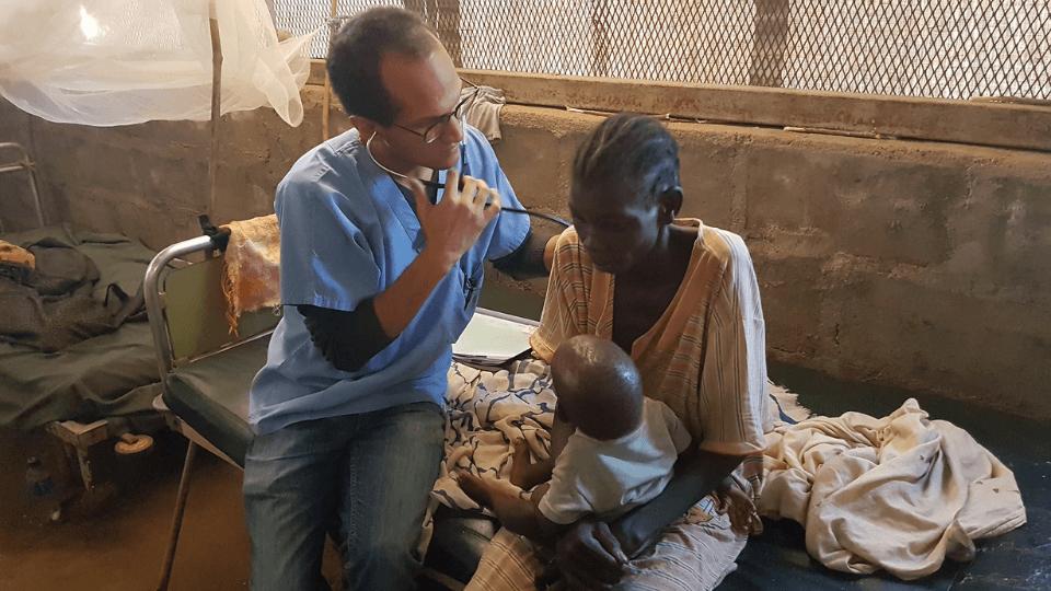 Dr. Jose checks on a patient in Sudan in 2019