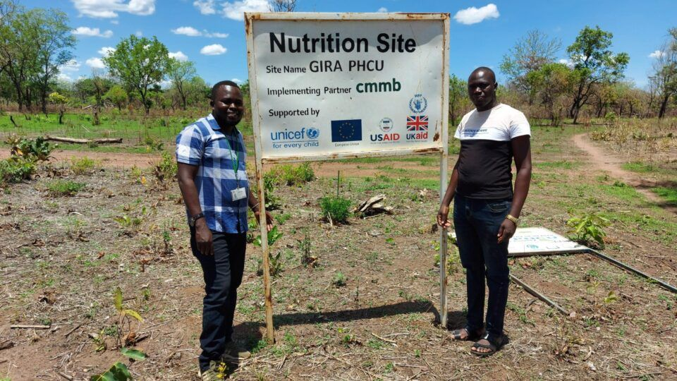 william and colleague in front of nutrition site