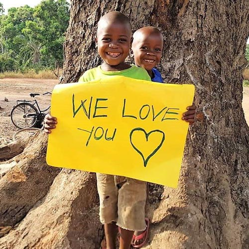Kenya boy with love you sign
