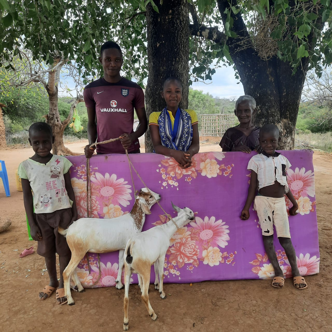 kanuu family in kenya with their new mattress and goats