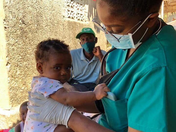 stephanie volunteer cares for baby in haiti