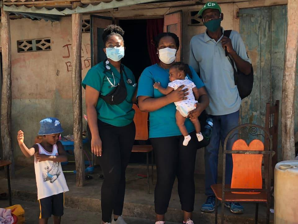 health workers with child at home