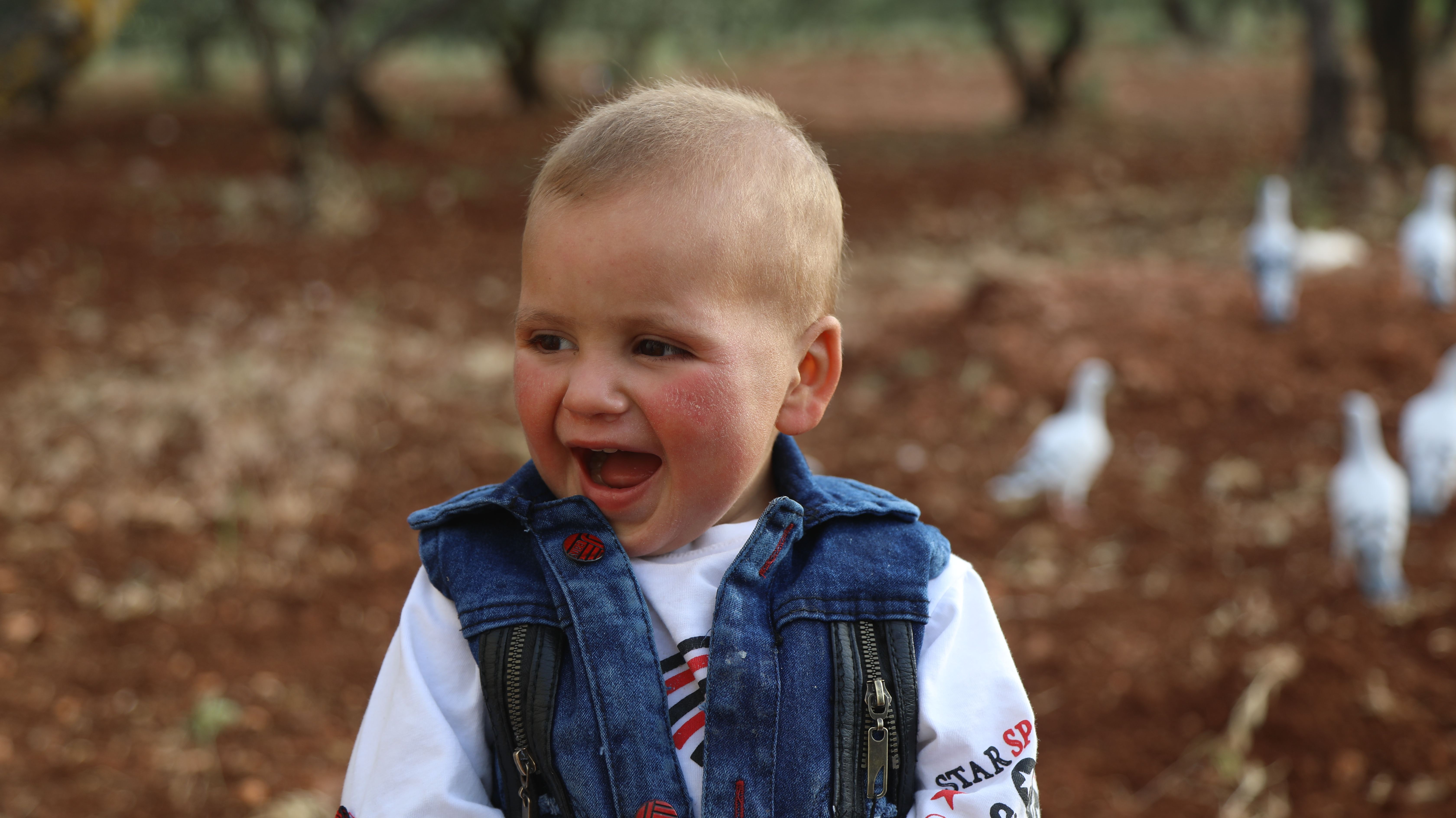 child in syria smiling