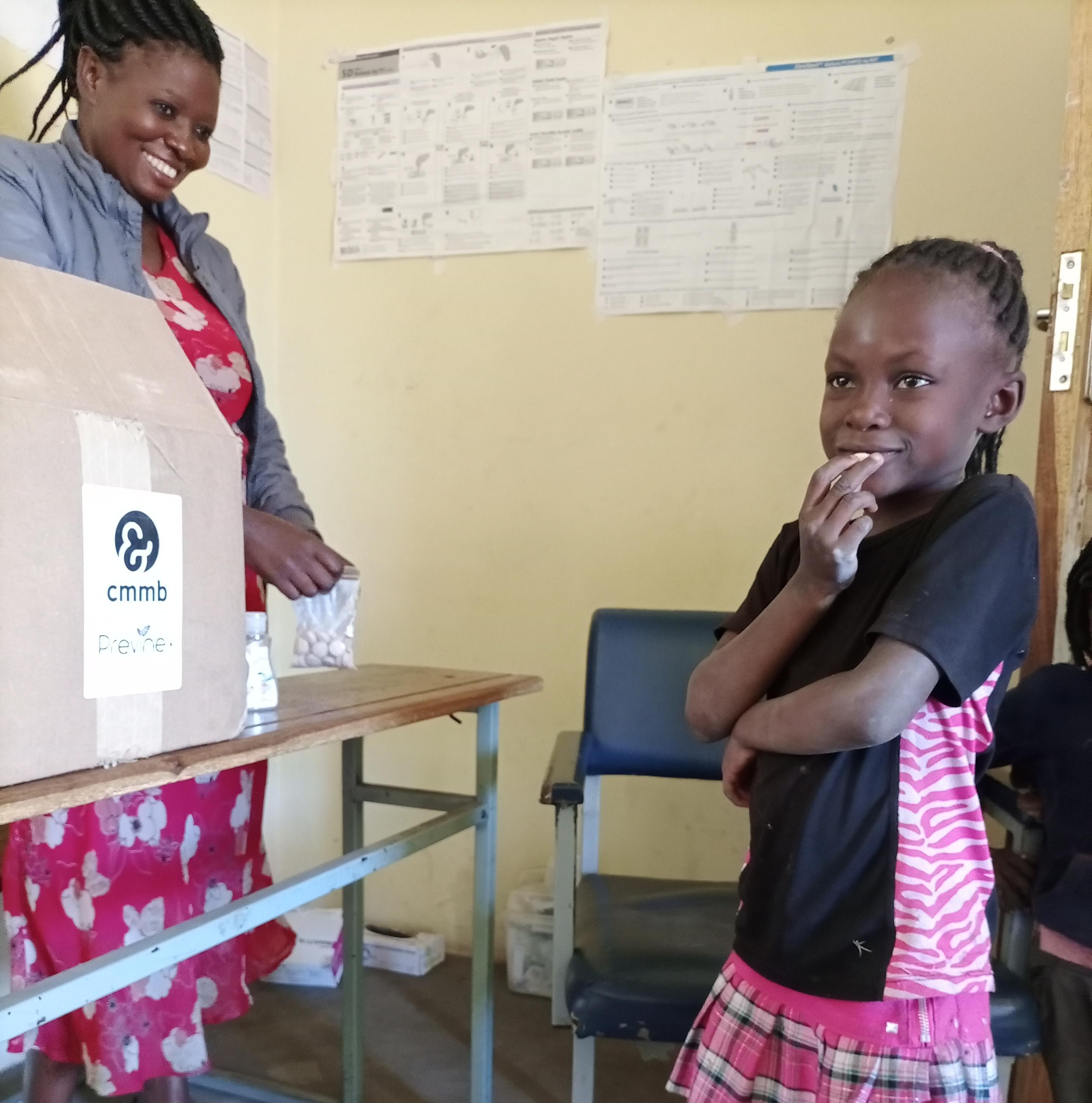 child in zambia taking multivitamin