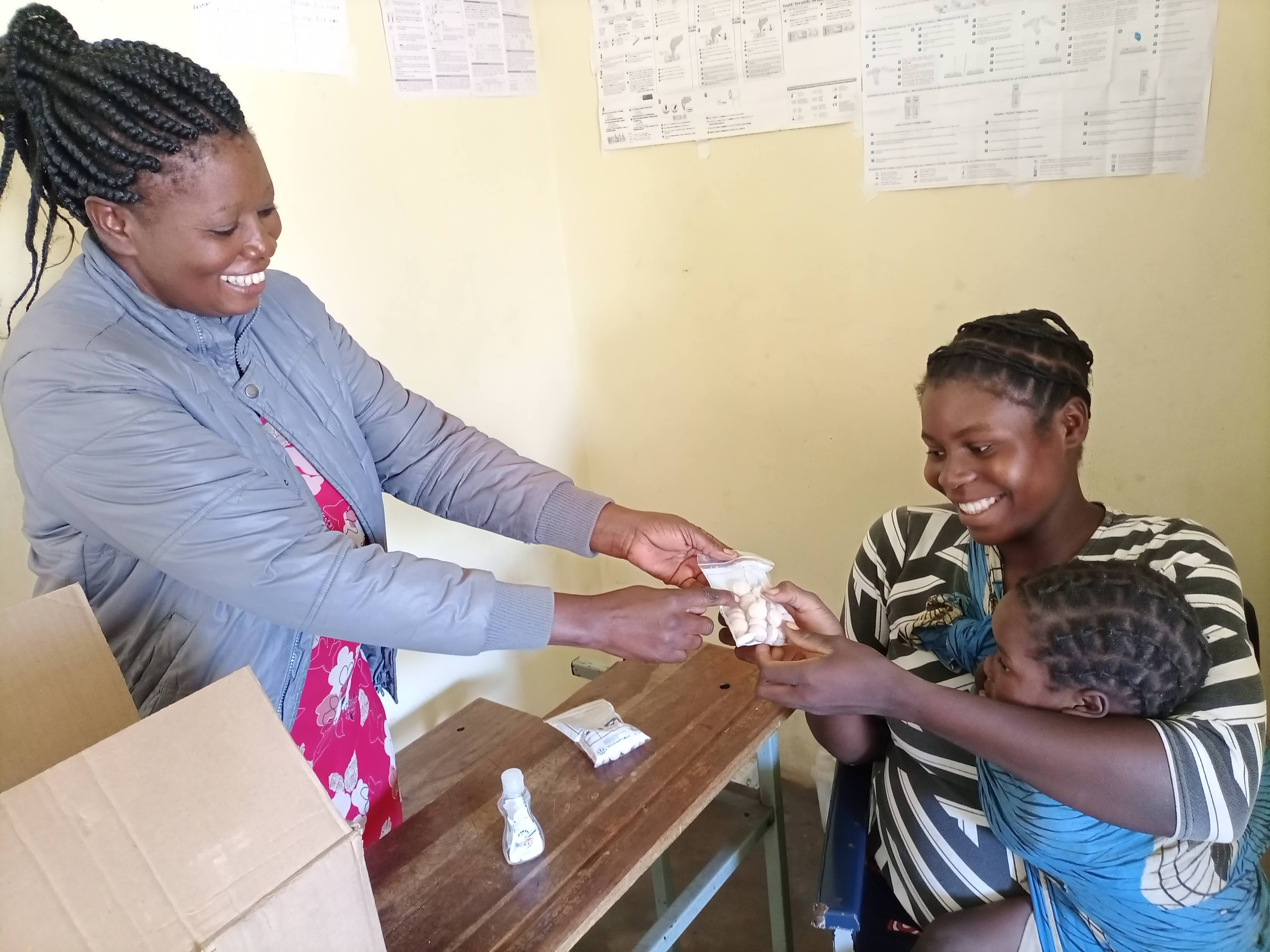 women and child receive vitamins in zambia
