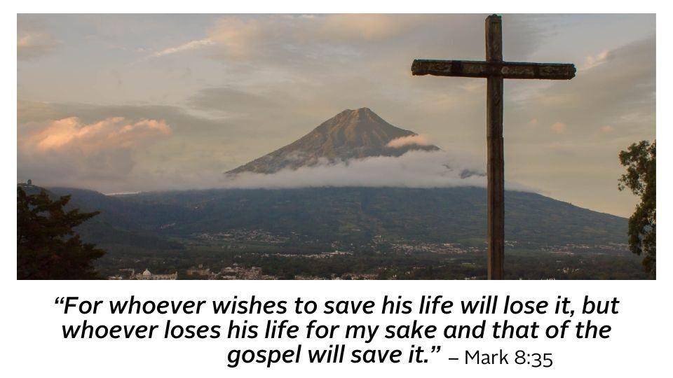 cross overlooking a mountaintop with bible scripture below