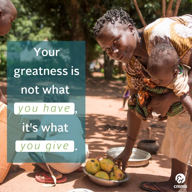 Mom and children with fruits from South Sudan. Quote: Your greatness is not what you have, it's what you give.
