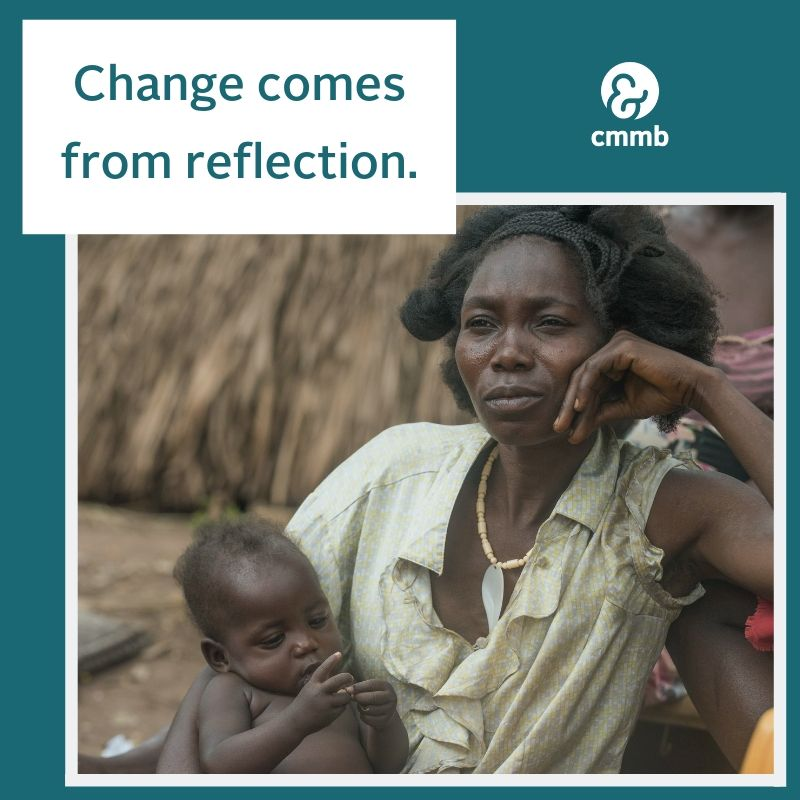 """Mother and baby from South Sudan. Quote: """"Change comes from reflection."""""""