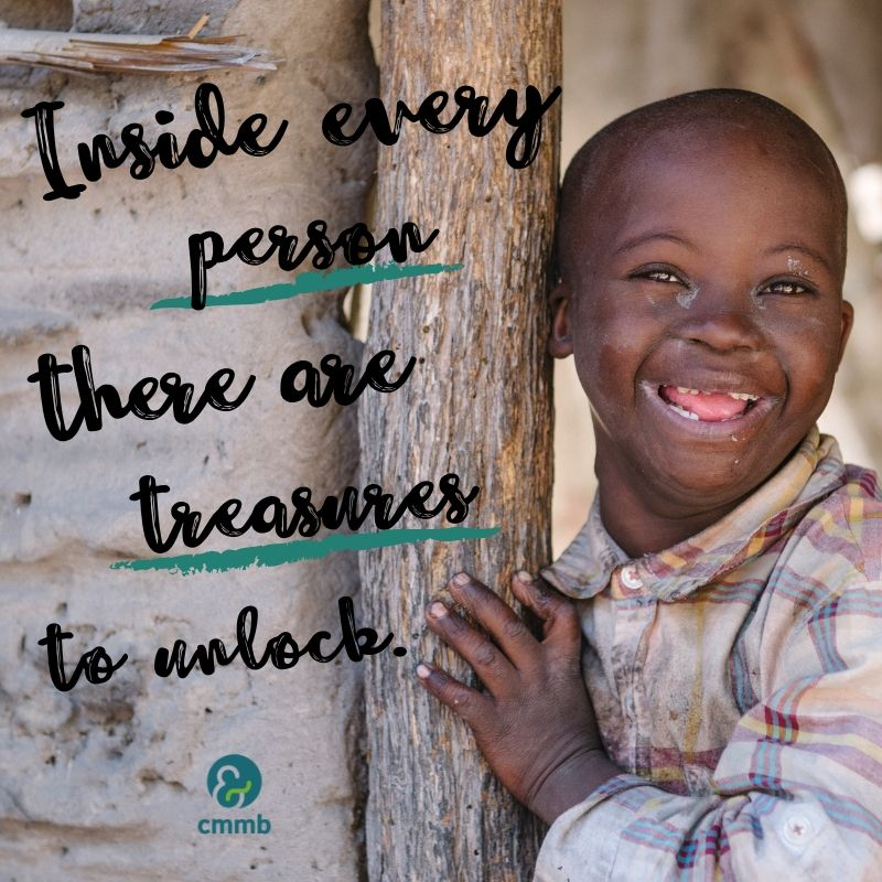 Boy smiling from Zambia. Quote: Inside every person there are treasures to unlock.