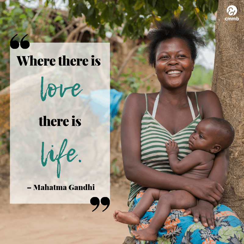 """Mother holding baby from Kenya, Quote: """"Where there is love, there is life."""" - Mahatma Gandhi"""