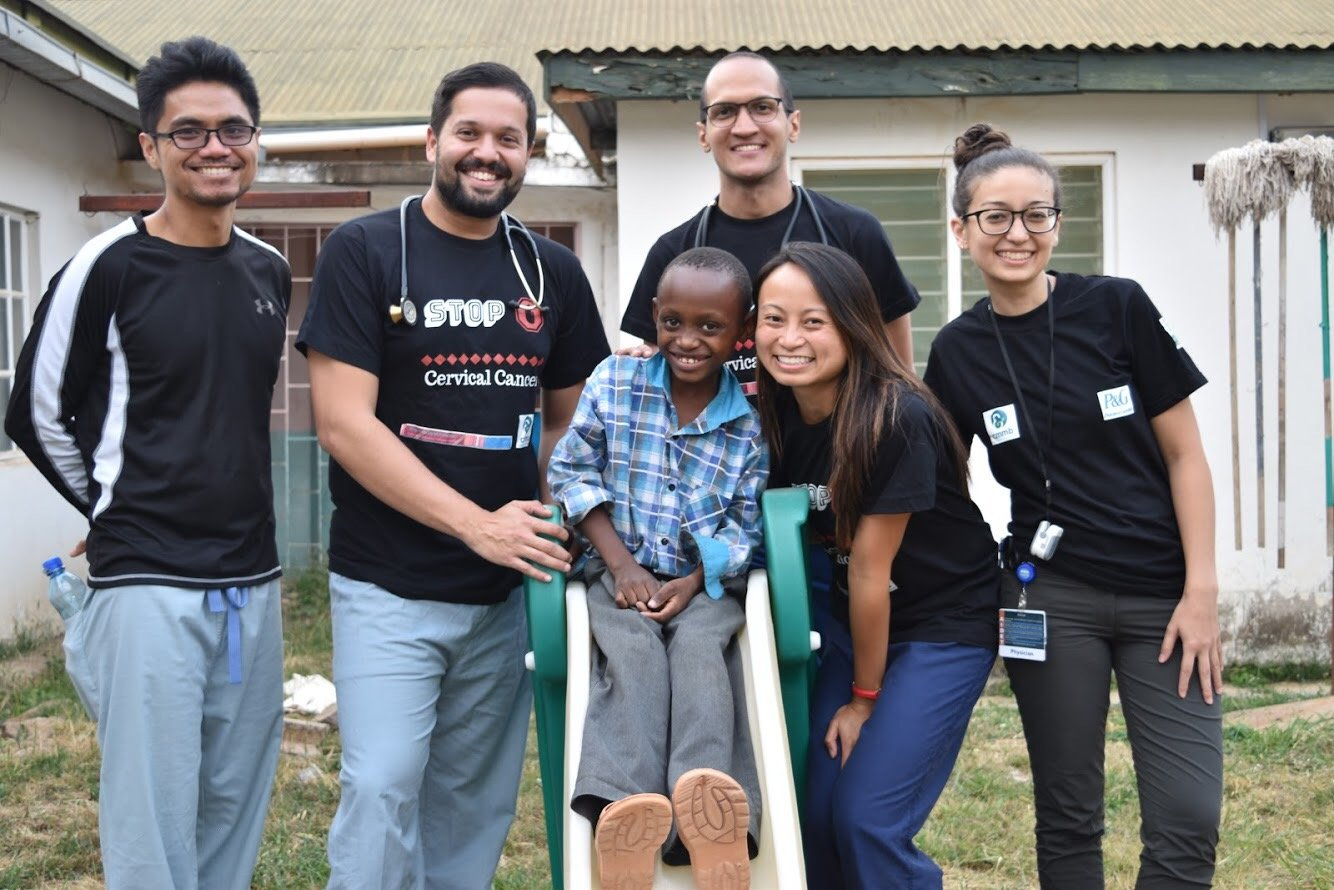Jose with his fellow volunteers, and a patient
