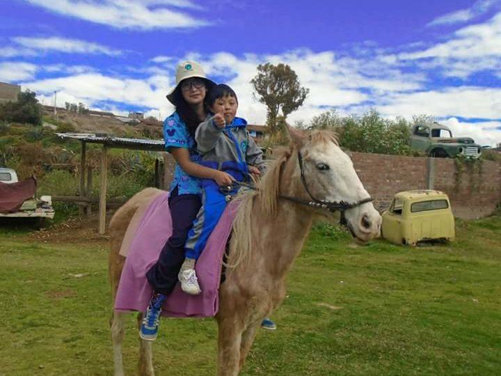 Kenyi riding a horse