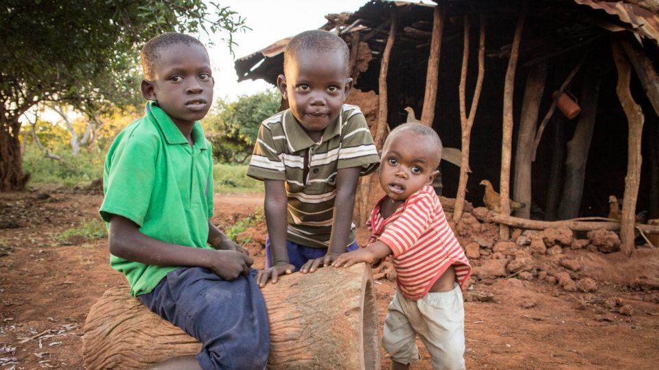 three brothers near their home in Kenya
